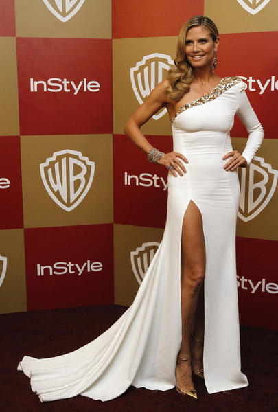 Model Heidi Klum poses at the InStyle/Warner Bros. after party following the 70th annual Golden Globe Awards in Beverly Hills, Calif.