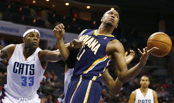 Indiana Pacers power forward David West (21) looses control of the ball against Charlotte Bobcats center Brendan Haywood (33) during the second half of their NBA basketball game in Charlotte, North Carolina January 15, 2013.