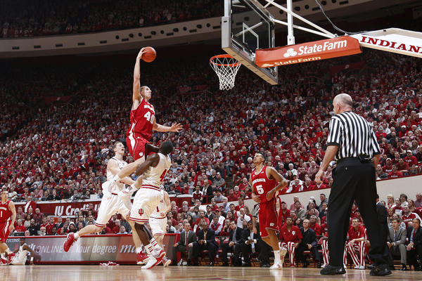 Jared Berggren #40 of the Wisconsin Badgers goes up for a dunk against Victor Oladipo #4 of the Indiana Hoosiers during the game at Assembly Hall on January 15, 2013 in Bloomington, Indiana.
