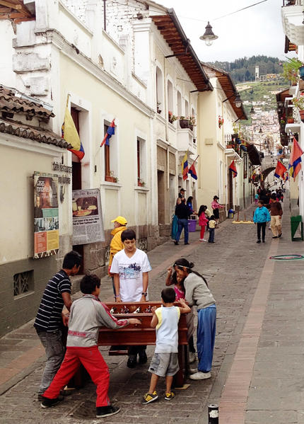 Kids playing foosball in Quito, Ecuador's Old Town neighborhood on June 23, 2012. Bustling with revelers and music after dark, this popular nightlife street, Calle La Ronda, is quieter by day.