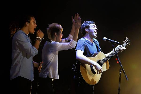 Deandre Brackensick, , left, Colton Dixon and Phillip Philips perform as part of the American Idol Live! tour.