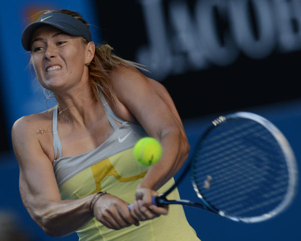 Russia's Maria Sharapova plays a return during her women's singles match against Misaki Doi of Japan on the third day of the Australian Open tennis tournament in Melbourne on January 16, 2013.