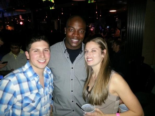 "The Bears' Zach Bowman (middle) with ""Hardcore Pawn: Chicago"" cast members Nate Cohen (left) and Elyse Cohen (right) at Toby Keith's I Love This Bar and Grill in Rosemont Dec. 31, 2012."