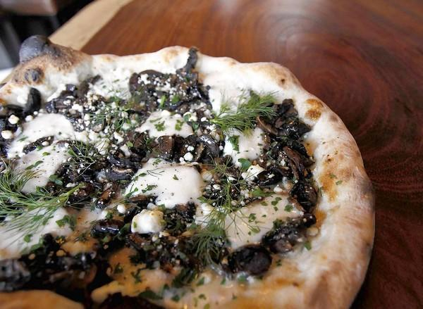A wild mushroom and goat cheese pizza with mozzarela  at the Wine Gallery in Laguna Beach.