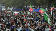 ISLAMABAD, Pakistan — Pakistan's embattled civilian leadership declared Wednesday it would not succumb to large anti-government protests, calling the demands made by demonstrators unrealistic because they require changes to the country's constitution.