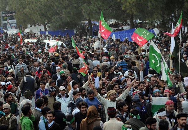 Protesters gather at a rally in Islamabad. Thousands of protesters near parliament say they want the dissolution of federal and provincial legislatures and the establishment of nonpartisan election commissions that can keep corrupt incumbents off the ballot.