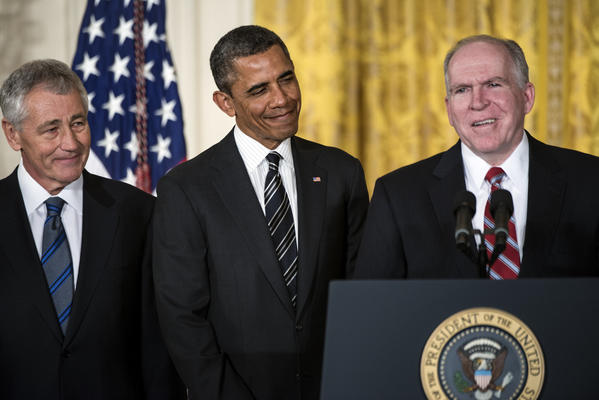 Chuck Hagel and US President Barack Obama listen to John Brennan speak during an event in the East Room of the White House January 7, 2013.