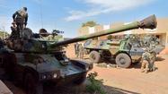 PARIS — A column of about 30 French tanks and several troop carriers, accompanied by a helicopter, crossed into Mali from Ivory Coast in an international mission to take control of the African nation's north from Islamist extremists, French media reported Monday night.
