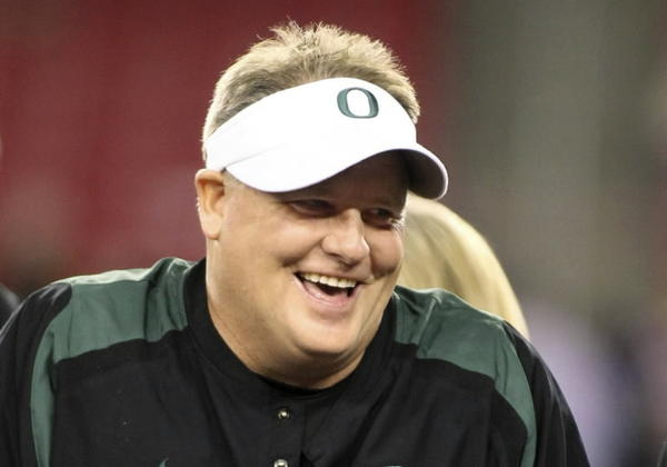 Oregon Ducks head coach Chip Kelly smiles after defeating the Kansas State Wildcats following the Fiesta Bowl football game in Glendale, Arizona, in this January 3, 2013 file photo. Kelly is headed to the NFL and will be named the new head coach of the Philadelphia Eagles according to news reports. REUTERS/Ralph Freso/Files (UNITED STATES - Tags: SPORT FOOTBALL) ORG XMIT: TOR410