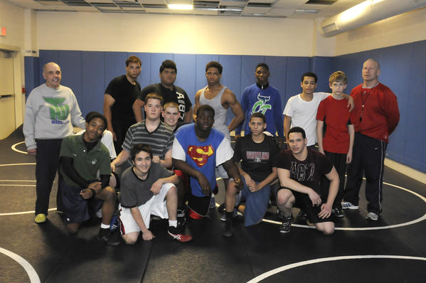 Hartford co-op wrestling coach Paul Meyers leads a wrestling practice at Hartford Public High School. A unified team was created pulling wrestlers from several differnt schools.
