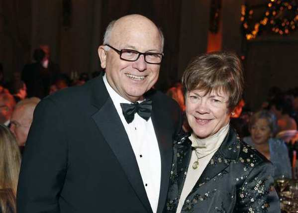Bill and Susan Baribault celebrate the holidays at the USC Thornton School of Music 's Charles Dickens dinner.