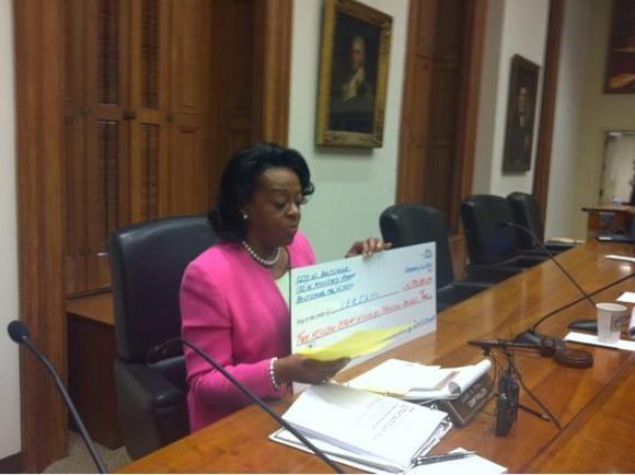 Baltimore Comptroller Holds Jumbo Check to Represent Wasteful Spending