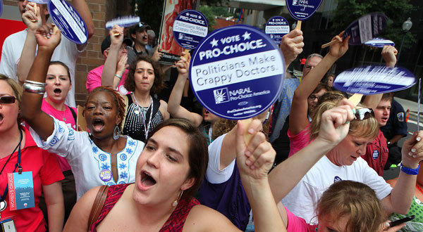 Pro-choice demonstrators shout at antiabortion protesters during a rally last year in Charlotte, N.C. A new Pew Research Center poll found that abortion was no longer a prime concern for a majority of Americans.