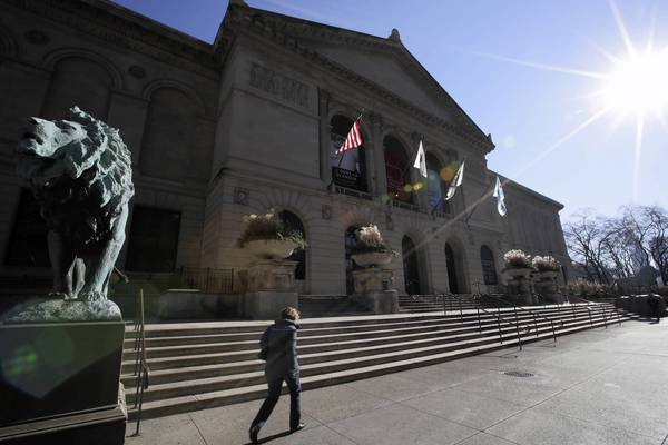 Bright midday sun shines on the iconic lions at the entrance of the Art Institute of Chicago. The Chicago Park District is considering increasing its fees for visitors to the museum.