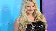 "<span style=""font-size: small;""><a href=""http://people.zap2it.com/p/jessica-simpson/167038"">Jessica Simpson</a> does plan to walk down the aisle with her fiance of two years, Eric Johnson. She just doesn't want to do it pregnant. The pop star and fashion mogul, who just signed on to star in an NBC sitcom pilot based on her life, says that she and Johnson have set two wedding dates -- but both times, they've had to be postponed because she didn't want to wear a maternity wedding dress.</span>"