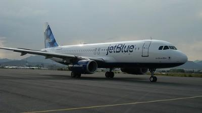 JetBlue aircraft with blueberry tailfin