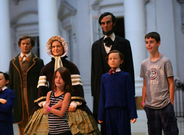 Art Reinstein of Vernon Hills photographs his kids Sammie, 8, Lexi, 6, and Noah, 11 (left to right) at the Abraham Lincoln Library and Presidential Museum Springfield, Ill. on August 18, 2011.
