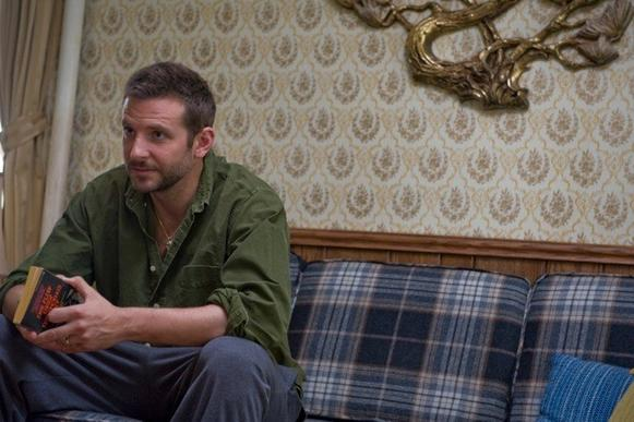 "In ""Silver Linings Playbook,"" Pat Solitano (Bradley Cooper) comes back home to live with his parents. Production designer Judy Becker asked Italian American friends about the homes they grew up in. ""Flocked wallpaper and paintings of the Last Supper came up,"" she said, ""but I didn't want the rooms to be cliche."" Instead, she used ornate 1970s decor. The sofa, purchased at a Salvation Army store, was recovered in a plaid wool by <a href=""http://www.osborneandlittle.com/products-and-collections/fabric"">Osborne & Little</a>."