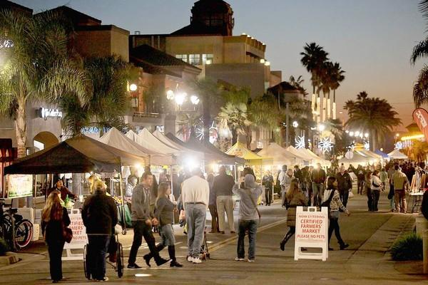 Surf City Nights Street Fair and Farmers Market in Huntington Beach draws a big crowd.