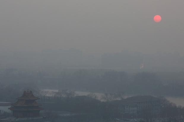 A view of the pollution shrouding the watchtower of the Forbidden City on Jan. 16.