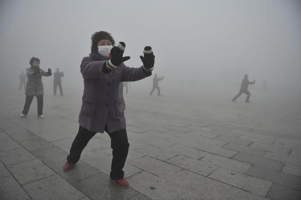 Retirees practice tai chi during their morning exercise on a hazy day in Fuyang, in central China's Anhui province, Jan. 14. Air pollution is a major problem in China due to the country's rapid pace of industrialization, reliance on coal power, explosive growth in car ownership and disregard for environmental laws.
