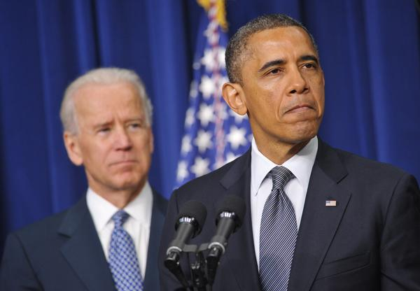 President Obama speaks on proposals to reduce gun violence as Vice President Joe Biden watches Wednesday at the Eisenhower Executive Office Building, next to the White House.