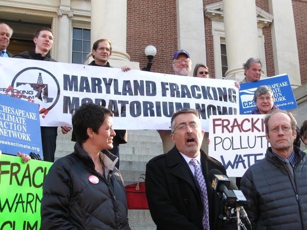 Climate activist Mike Tidwell, flanked by Del. Heather Mizeur and fracking commission member Paul Roberts, speak to news media on State House steps about why a moratorium on shale gas drilling is needed until studies are completed.