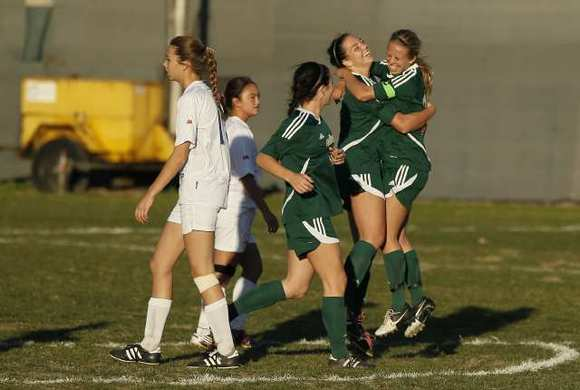 Edison's Brooke Lillywhite, right, hugs MacKenzie Cerda after she scored a goal against Fountain Valley during a Sunset League game on Tuesday.