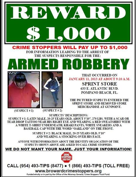 Two men wanted for armed cell phone store robbery