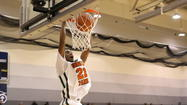 Morgan Park's Josh Cunningham dunks earlier this season. No. 2 Morgan Park faces No. 3 Simeon tonight at Chicago State.