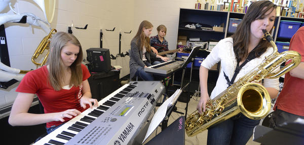 Members of the Waynesboro Area Senior High School Jazz Ensemble Emily Shover, left on keyboard, and Alli Harbour, right, on baritone sax practice for the upcoming Swingtown Dinner Dance fundraiser.