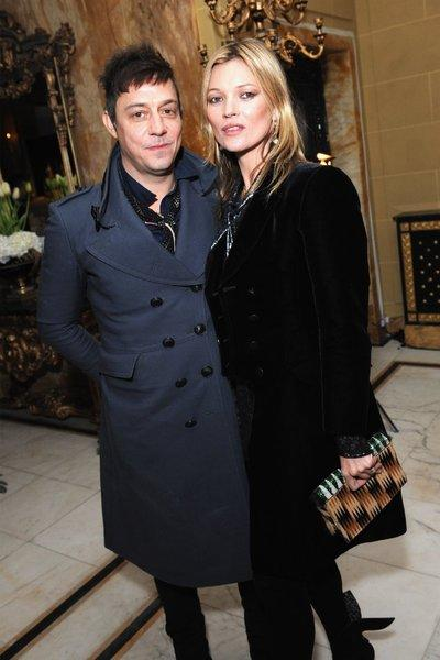 Jamie Hince and Kate Moss pose at miu-miu-london, a temporary women's club in London.