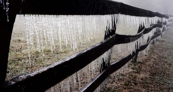 Icicles hang from a wooden fence along Ritchie Road near Cascade on Wednesday. A winter storm system headed toward Maryland could dump more than four inches of snow in central and southern Maryland but Washington County is expected to be largely spared of any significant snow accumulation, a National Weather Service spokesman said Wednesday night.