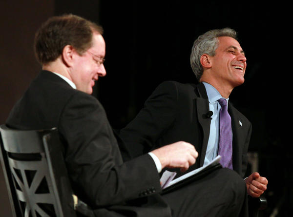 Bruce Dold, left, of the Chicago Tribune, and Chicago Mayor Rahm Emanuel share a laugh during a light moment while discussing a range of issues affecting Chicago in a public forum at The Field Museum on Wednesday.