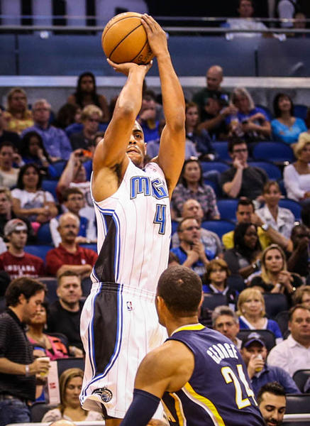 Magic guard Arron Afflalo (4) shoots over Indiana's Paul George (24) during first quarter action of a game against the Indiana Pacers at Amway Center in Orlando, Fla. on Wednesday January 16, 2013.