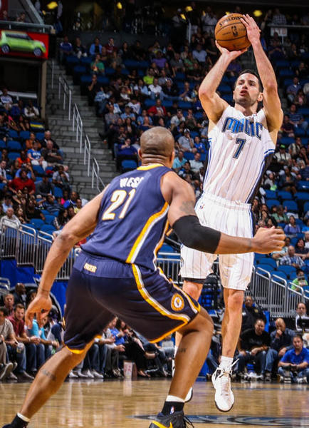 Magic guard J.J. Redick (7) shoots over Indiana's David West (21) during third quarter action of a game against the Indiana Pacers at Amway Center in Orlando, Fla. on Wednesday January 16, 2013.