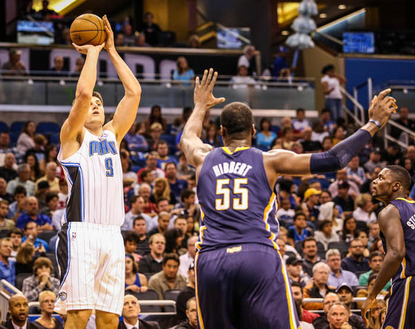 Magic center Nikola Vucevic (9) shoots over Indiana's Roy Hibbert (55) during second quarter action of a game against the Indiana Pacers at Amway Center in Orlando, Fla. on Wednesday January 16, 2013.