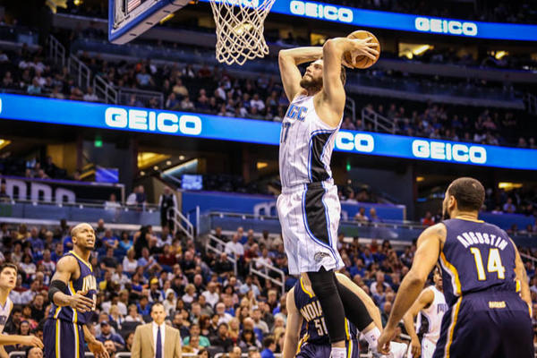 Magic forward Josh McRoberts (17) dunks the ball off an assist from Nikola Vucevic (9) during second quarter action of a game against the Indiana Pacers at Amway Center in Orlando, Fla. on Wednesday January 16, 2013.