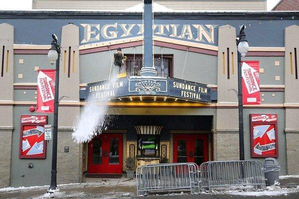 Peter Mayhew, technical director of the Egyptian Theatre, shovels snow off the marquee before the start of the 2013 Sundance Film Festival.