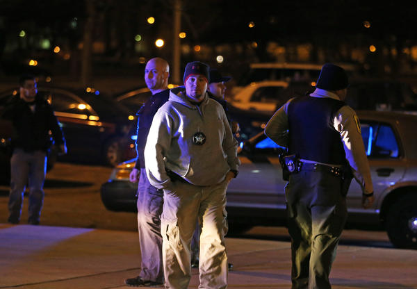 Police gather information at the scene of a shooting in the parking lot of the Jones Convocation Center at Chicago State University, 9501 S. King Dr., in Chicago. The shooting happened following the boys' high school basketball game between Simeon Morgan Park.