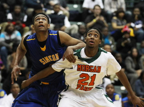 Simeon's Jabari Parker and Morgan Park's Josh Cunningham battle for position for a rebound Wednesday at Chicago State.