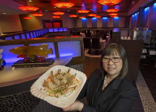 Manager Rosanna Pang holds a platter of salty pepper prawns inside Chopstick, a new restaurant at the Sands Casino Resort Bethlehem.