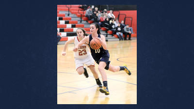 Turkeyfoot's Katie Ryan drives past Meyersdale's Katie Bolden in WestPAC girls basketball action Wednesday.