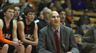 Huron boys' basketball coach Tim Buddenhagen figures that he had three heart attacks on the last day of November, but he was on the bench and coaching for the Tigers' season opener on Dec. 7.