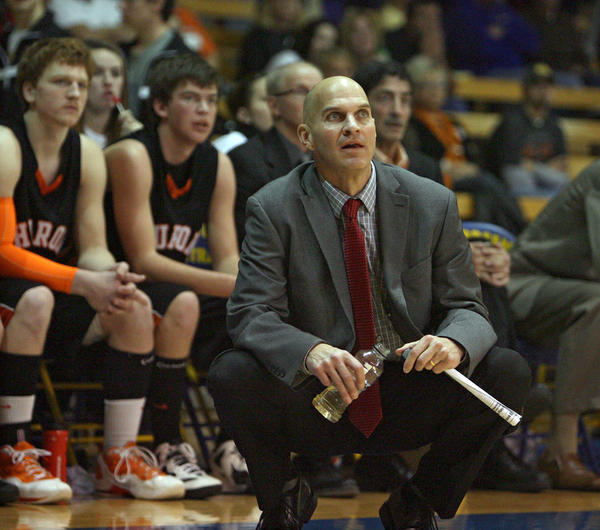 Huron boys' basketball coach Tim Buddenhagen watches the action during a recent Huron and Aberdeen Central game at Golden Eagles Arena. Buddenhagen is recovering from a series of heart attacks.