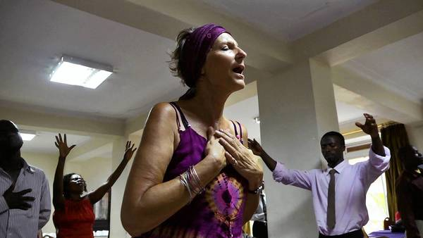 Rev. JoAnna Watson leading prayers in Kampala, Uganda, in the documentary 'God Loves Uganda,' the first feature length film by Easton native and Oscar winner Roger Ross Williams.