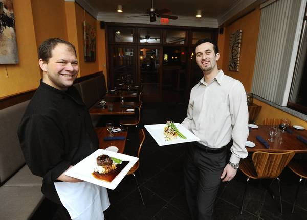 Nathan Roth Executive Chef (left) along with Arti Kamberaj General Manager of River Grille in Easton. is celebrating their 10th anniversary.