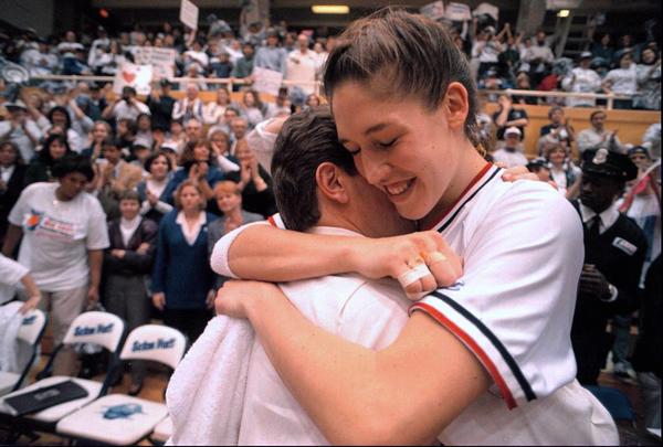 UConn Women's Basketball wins their fourth Big East Championship. Later on that season the Huskies defeated Tennessee and claimed their first National Championship. Rebecca Lobo hugs coach Geno Auriemma after Big East victory.