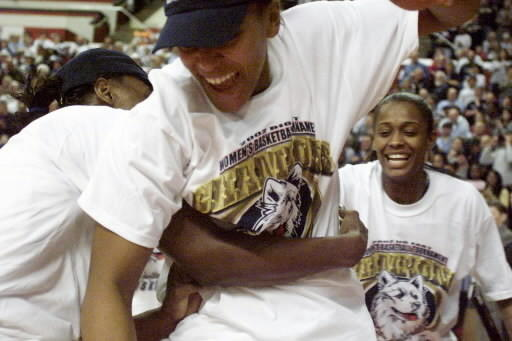UConn Women's Basketball wins their eleventh Big East Championship. The Huskies also won their third national championship in 2002. Here is Asjha Jones, Ashley Battle, and Swin Cash celebrating their Big East victory.