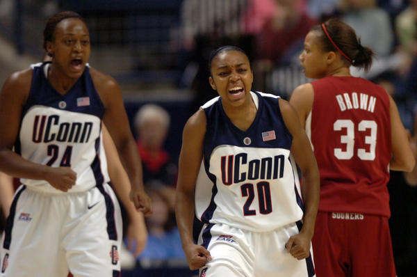 UConn Women's Basketball wins their twelfth Big East Championship. Renee Montgomery and Charde Houston celebrate a regular season victory.